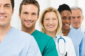 """<img alt=""""Healthcare LMS System smiling""""src=""""https://topyx.com/wp-content/uploads/2015/09/Healthcare_LMS_System.jpg""""/>"""