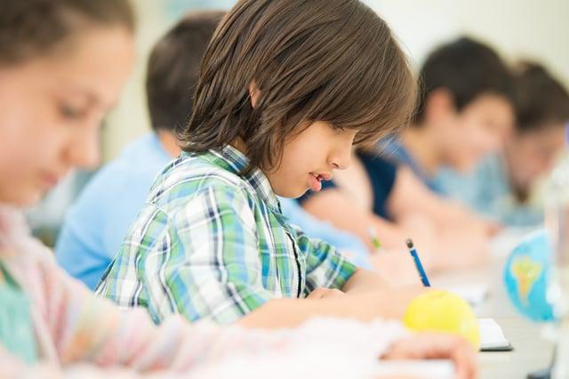 Cheerful kids learning in school classroom
