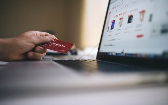 2 11-21 someone about to make a credit card purchase online sales trends.jpg
