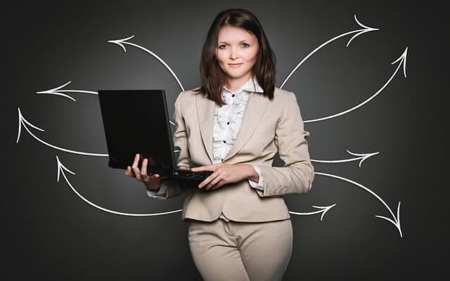 professional woman holding a laptop measure training 2.jpg