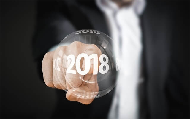 corporate man pointing at a '2018' bubble 2 (1).jpg