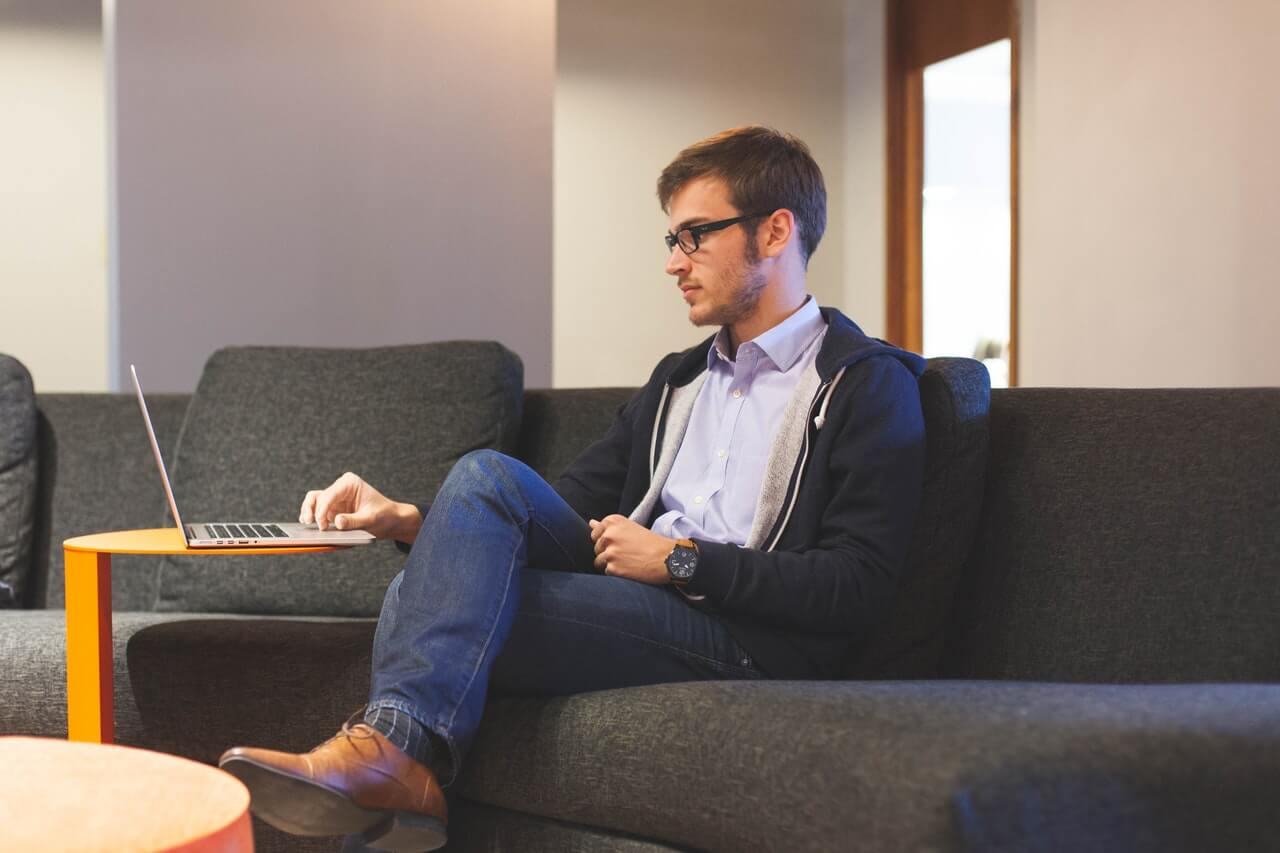 man on couch microlearning trends