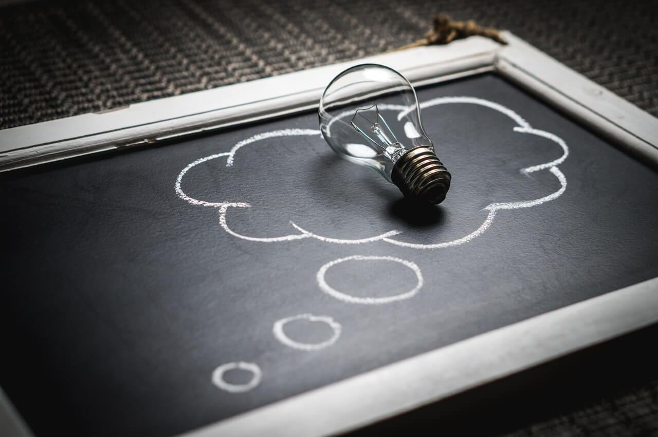 chalkboard with light bulb laying on it elearning continuous learning culture