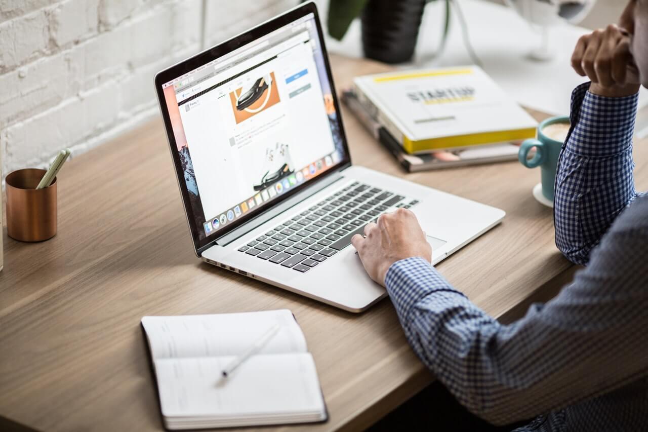 LMS software man at laptop