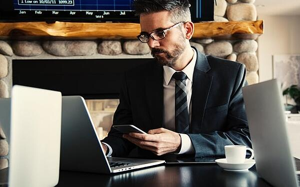 professional-looking man on laptop and phone training 2