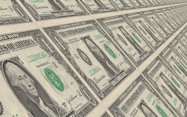 sheets of dollar bills save company money LMS.jpg