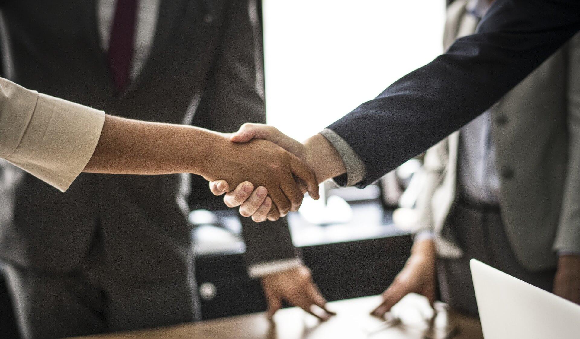 employee onboarding handshake business