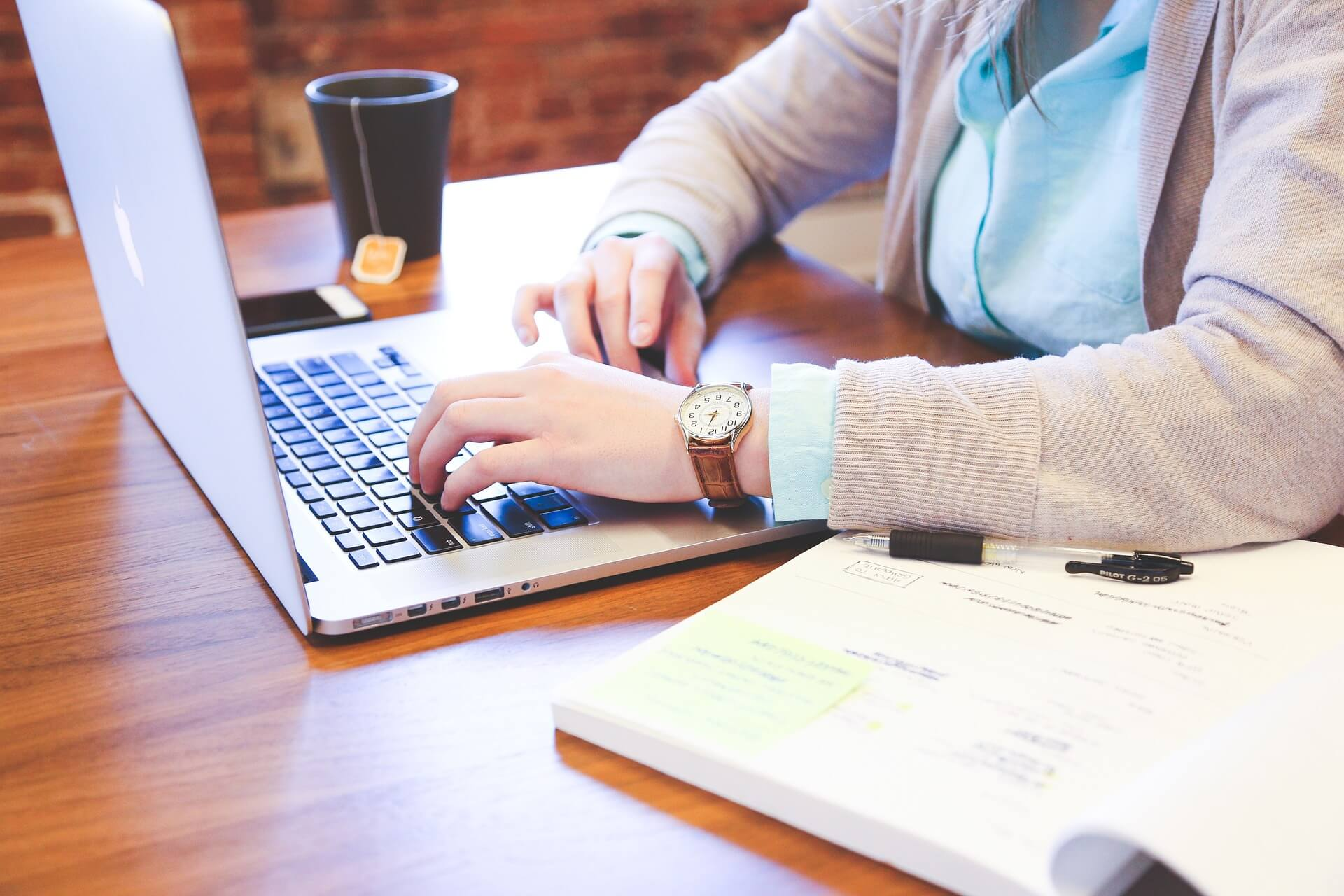 Woman on laptop lms stand for