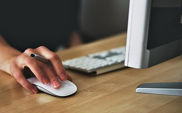 woman's hand on computer mouse corporate eLearning course 2.jpg